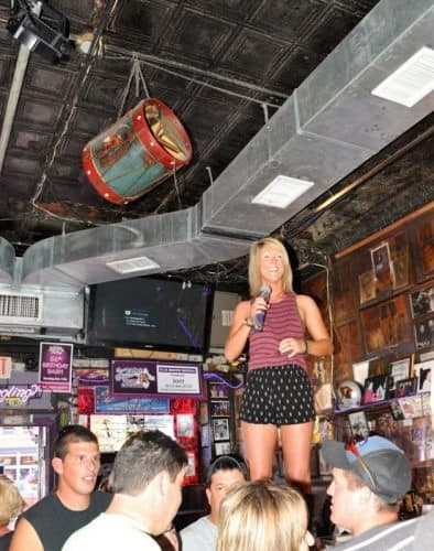 Singing on the bar comes naturally in Nashville, home to country music of all kinds.