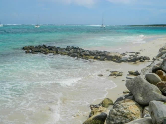 These rocks form the dividing line between topless and full on nude on Orient Beach.