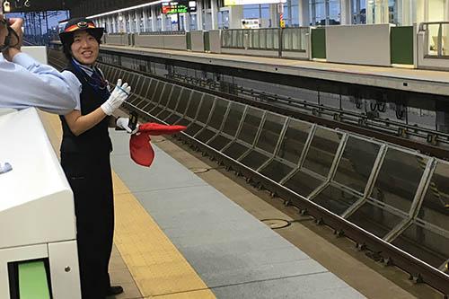 The Shinkansen conductor in Kyoto, Japan.
