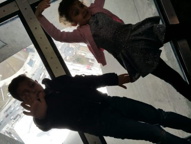 Kids playing at the CN Tower in Toronto, Canada.
