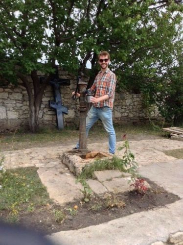 Helping myself to freshly-pumped water at Orheiul Vechi