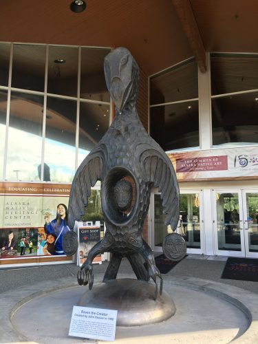 At the entrance to the Alaska Native Heritage Center