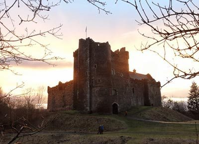Doune Caste's mighty keep and courtyard wall, caught in a Highland sunset.