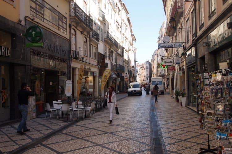 A shopping area in Lisbon with tiled streets.