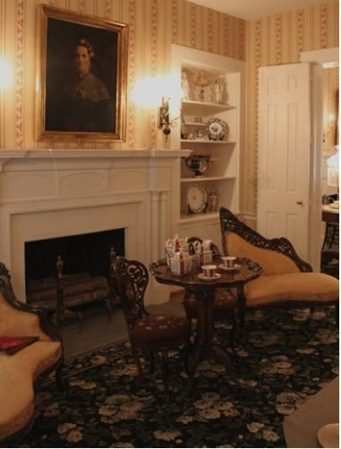 The ladies' parlor complete with a portrait of the first lady.