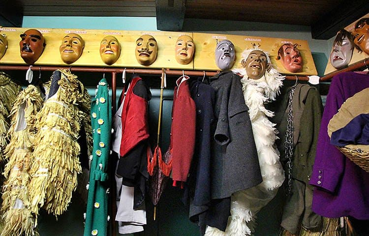 Costumes await in the staging room at Laufar Kamanda (headquarters).
