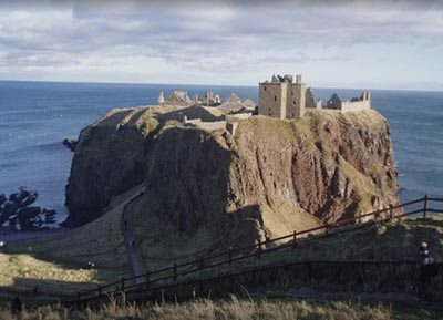 The fortress of Dunnottar, flanked by cliffs on three sides, viewed from the sole approach to the west.