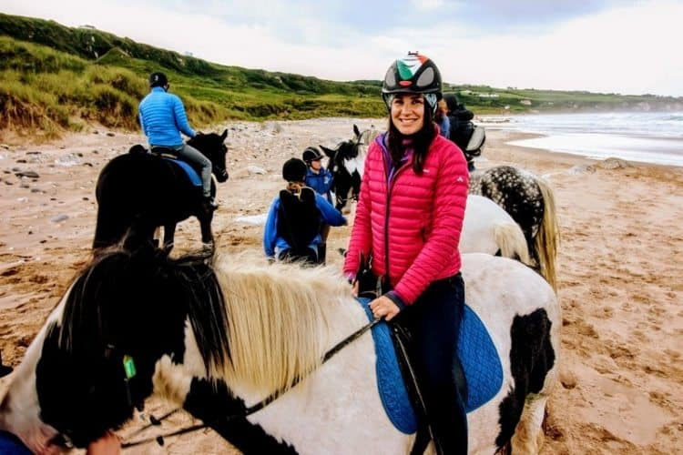 Riding horses on the beach in Northern Ireland.