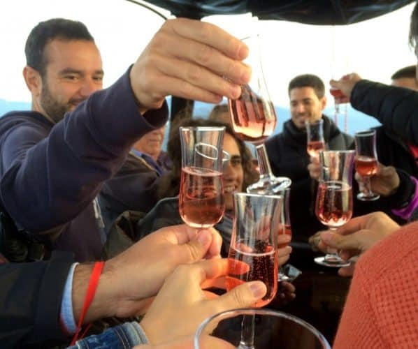 Spaniards don't wait until landing hot air balloons to break out champagne toasts
