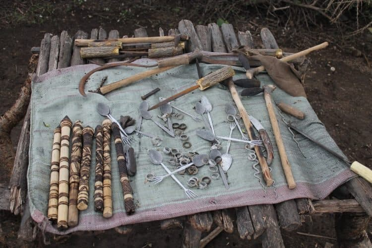 The tools used to create the blacksmith's creations laid out on the ground.