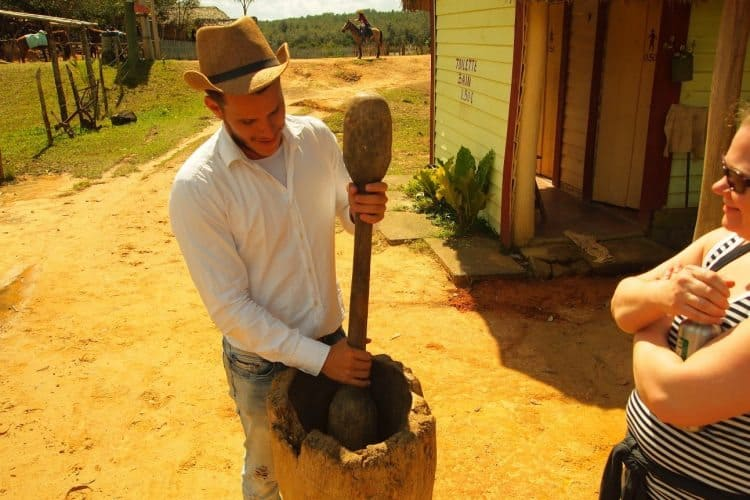 A farmer shows off his high tech coffee grinder in Vinales, Cuba.