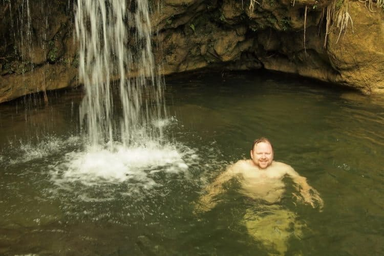 Enjoying a refreshing swim at a waterfall in Soroa, Cuba.