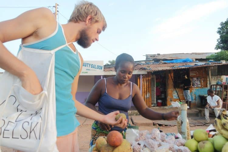 Buying fruits in the market in Gambia.
