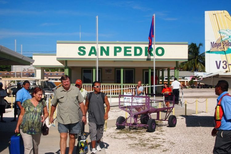 San Pedro's airport is right in the center of the town, a quick golf cart ride from the wharfs where boats take travelers to local resorts.