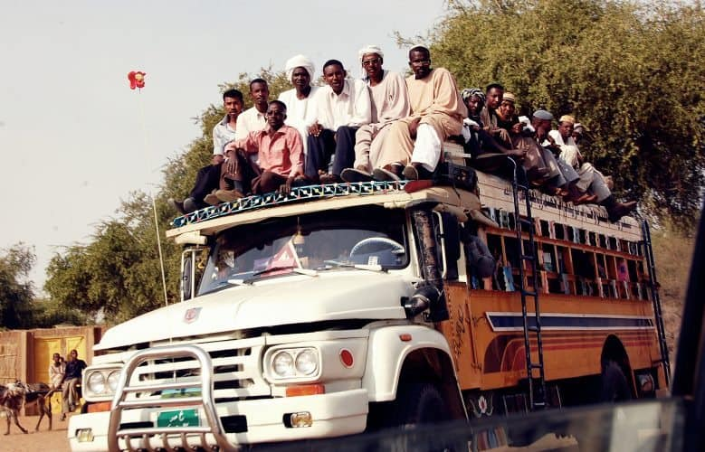 One popular way of getting around Sudan is atop a bus.