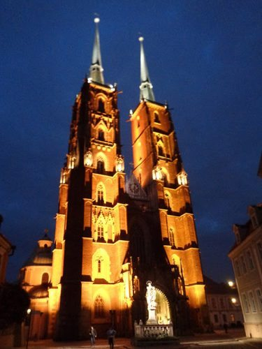 The Cathedral Wroclaw is dramatically lit up at night. In Poland.
