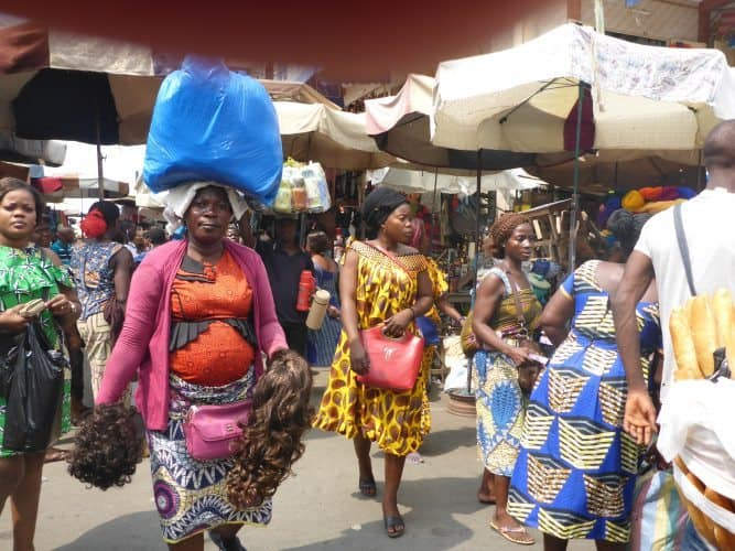 Women do the hard work in the fetish market in Togo, West Africa.