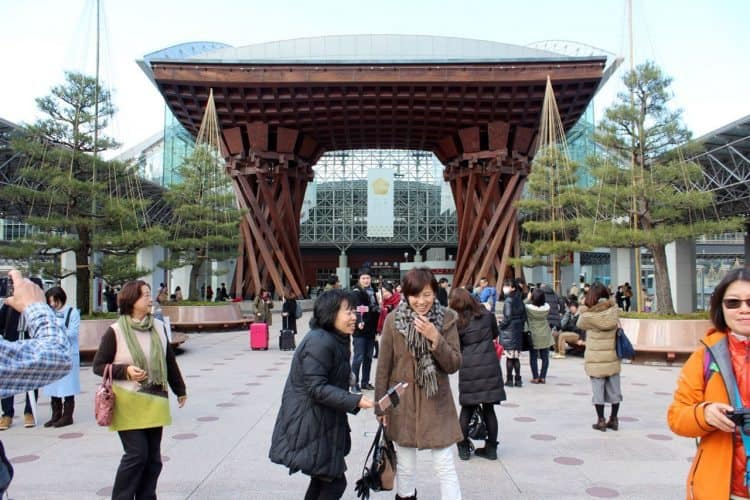 Tourists at Kanazawa station taking selfies