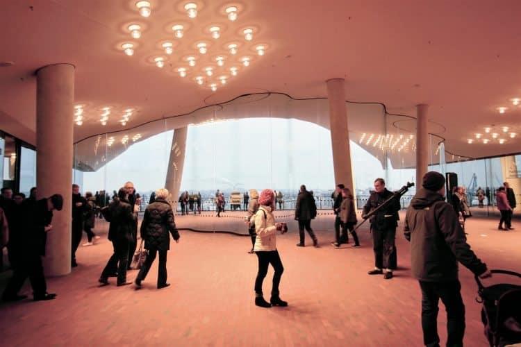 Inside the Elbphilharmonie the main atrium offers views of the harbor in Hamburg, Germany.