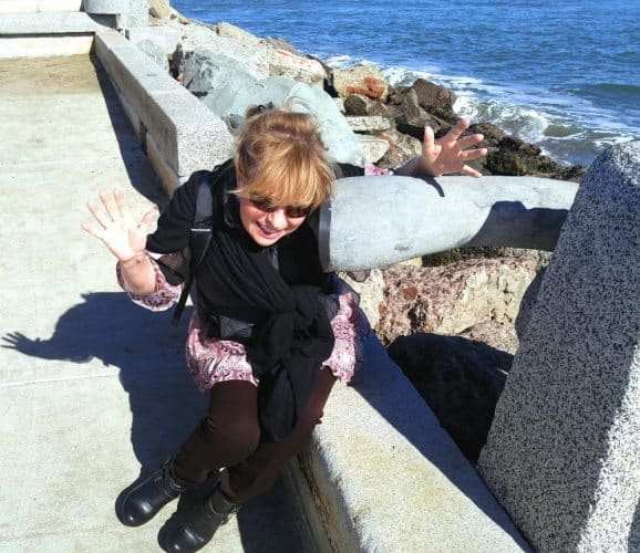 Listening to the sound of the waves at the Wave Organ in the Marina district, San Francisco.