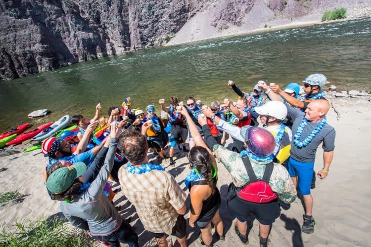 Newly diagnosed cancer patients shouldn't have to suffer isolation and alienation. Here, cheering another successful whitewater trip in Montana.