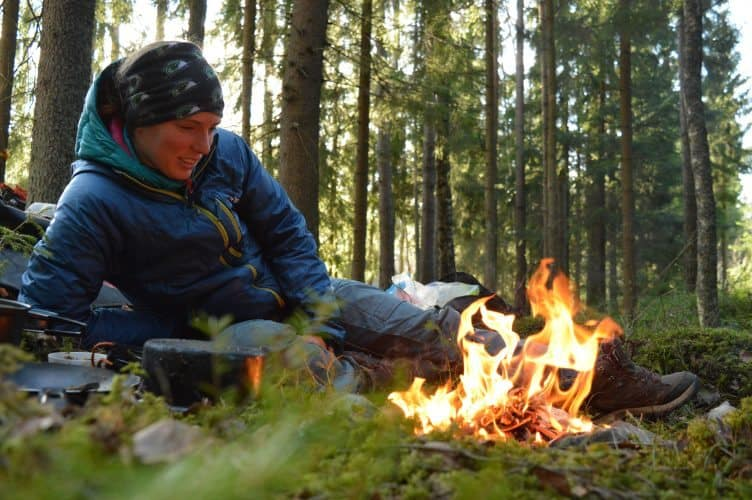 Enjoying a campfire while wild camping in Sweden.