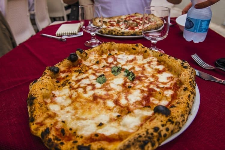Fuego's margherita pizza, the first pizza born in Naples, is named after Queen Margherita, who visited Naples in 1889 and it's been a traditional dish in the region ever since.