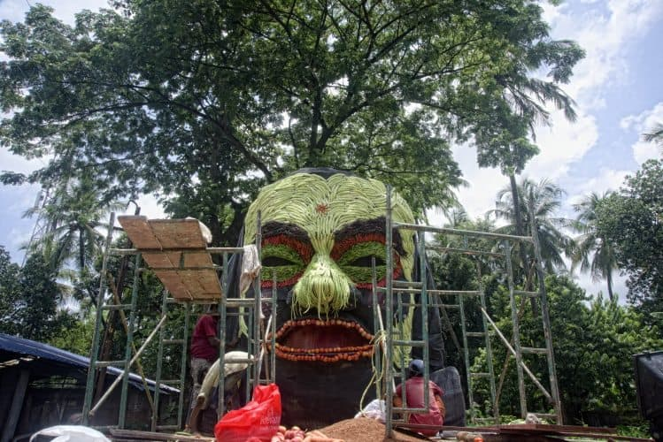 Floats been prepared before start of the procession during Pullikali Festival.