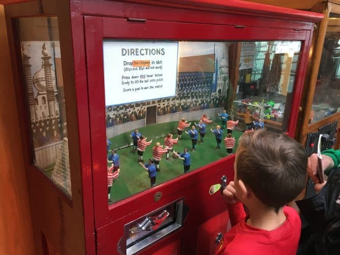 Kids play foosball inside the National Football Museum in downtown Manchester, England.