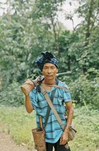Hunter with his handmade shotgun in th eMindat forest, Chin State, Burma