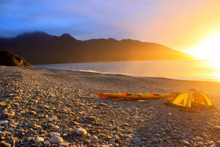 Camping on the remote Fjordland coast during a kayaking trip.
