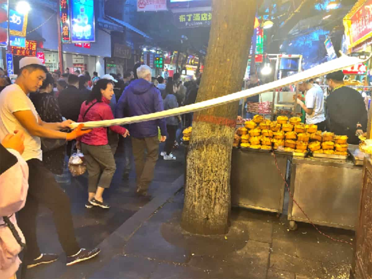 Noodle pulling at North Gate Night Market, Xi'an.