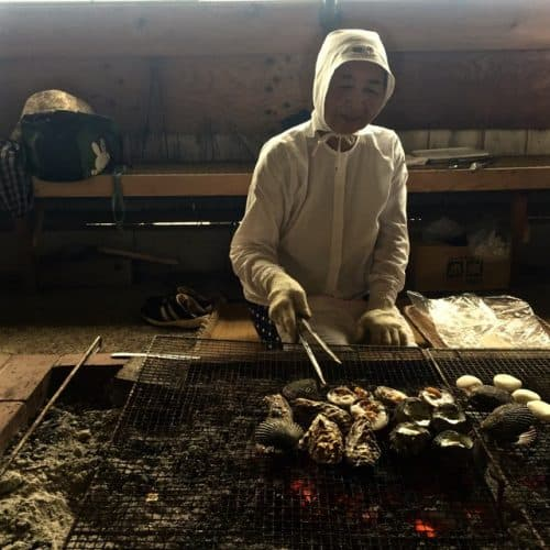 Ama grilling shellfish in an amagoya. Lauren Scharf photos.