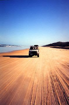Taking a Jeep on the vast and empty beaches of the island.
