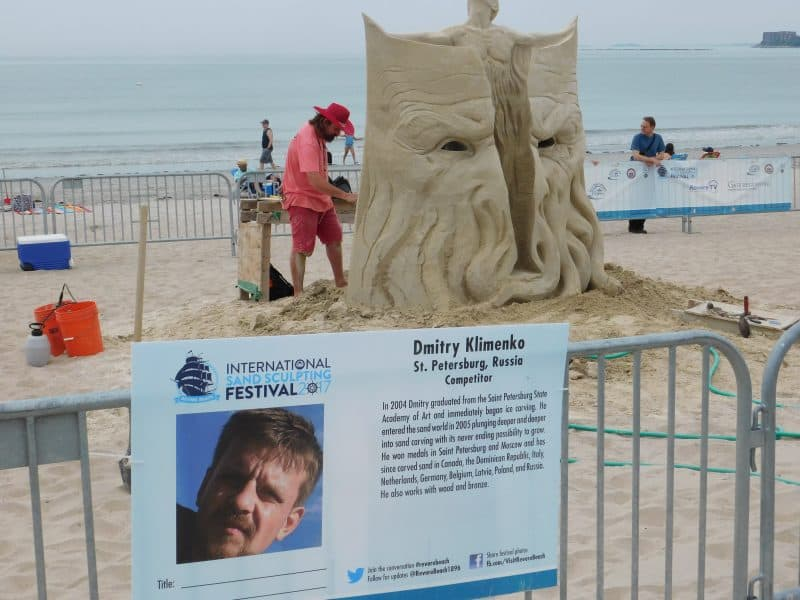 An artist working hard on his sculpture on Revere Beach.