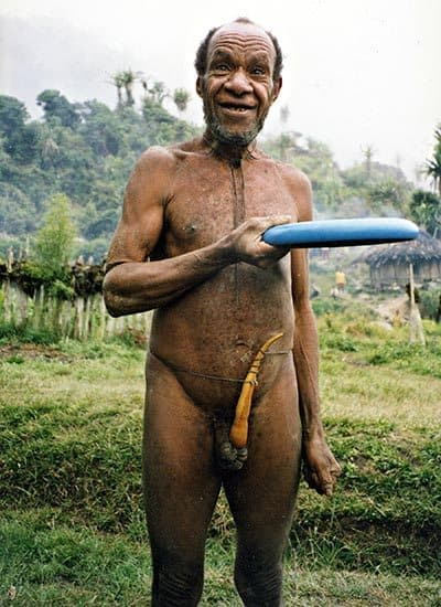 Dani Tribesman from Irian Jaya's Baliem Valley masters the Frisbee (aka West Papua).