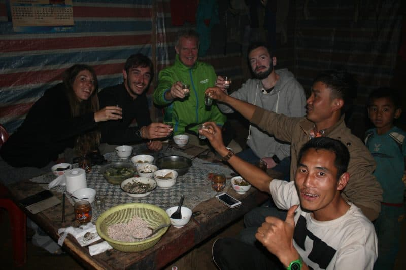 The gang drinking lao-lao in Penyenxang village. Boss is second from right.