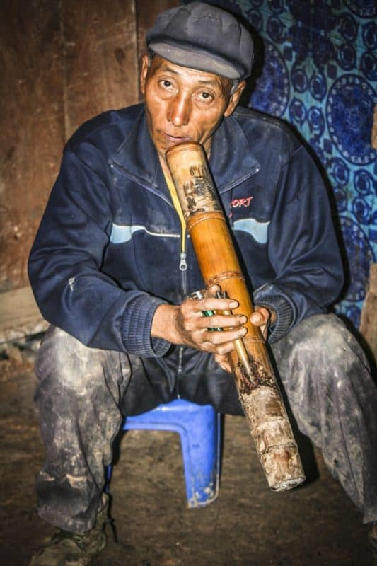 Village chief Nouje smokes a water pipe in his Chakhampa village.