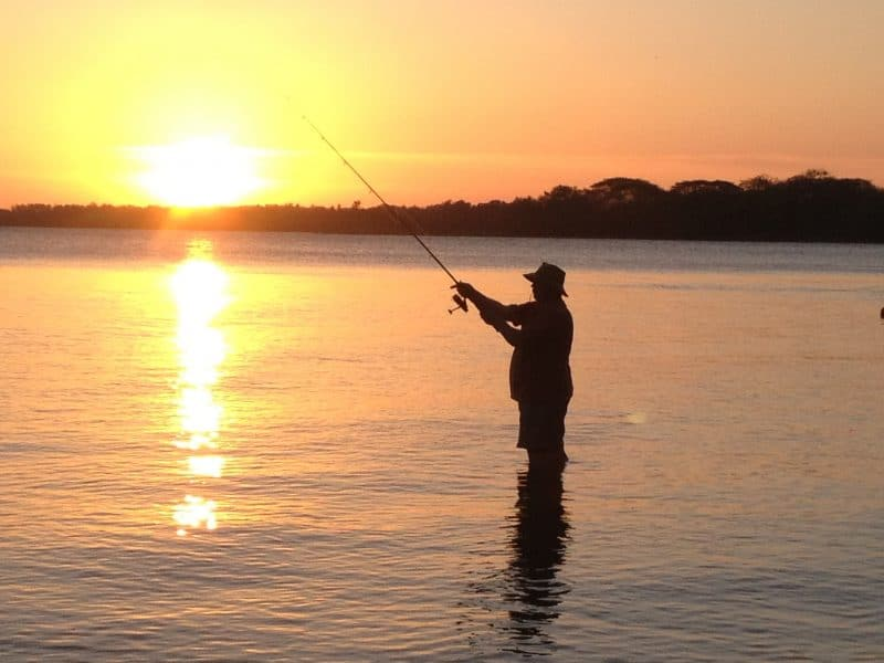 A fisherman hopes for a catch during a sunset along the shores of Lake Nicaragua on Ometepe Island.