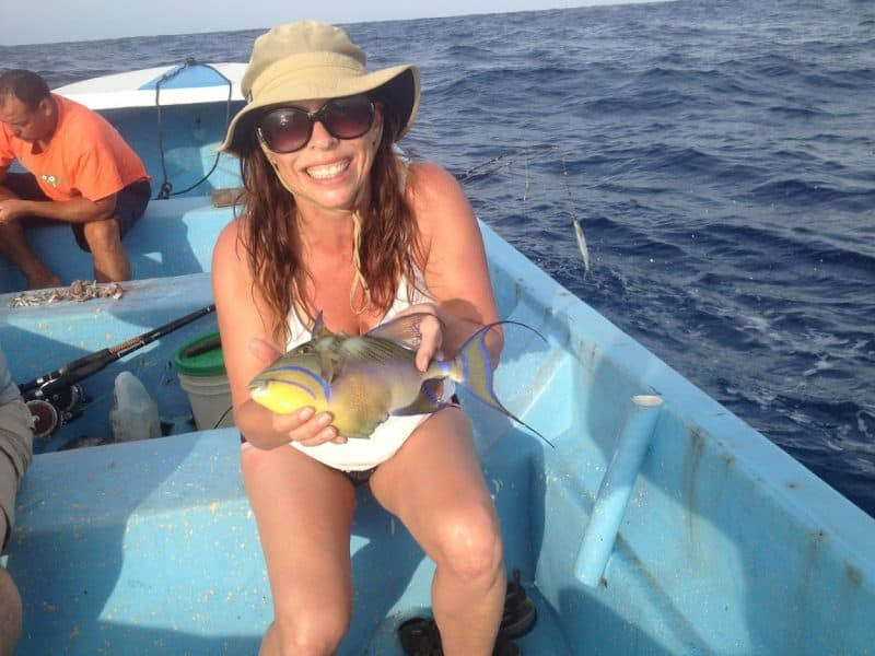Heide shows off her catch of the day during a deep sea fishing trip at Little Corn Island, Nicaragua.
