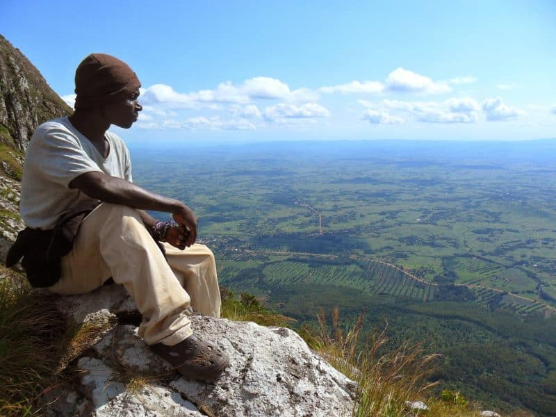 John takes in the view on top of the Island in the Sky. We could see surrounding areas that John had never been to even though he had spent all his life in Mulanje.