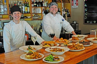 A couple of Traditions' chefs pose with some new delicious summer menu items. Photo courtesy of Purity Spring Resort