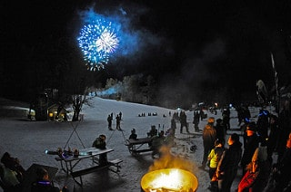 Fireworks at an event at King Pine Ski Area make for a lovely winter setting. Photo courtesy of Purity Spring Resort