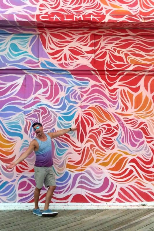 Asbury's animated murals attract animated visitors for some snapshots along the soon to be renovated Sunset Pavilion.