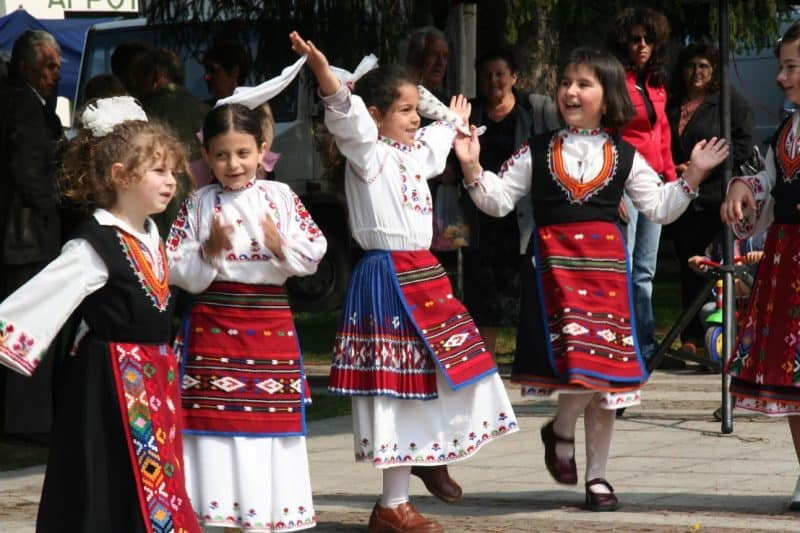 Every region in Bulgaria has its own costumes - white and black with red skirt are typical for Apriltsi