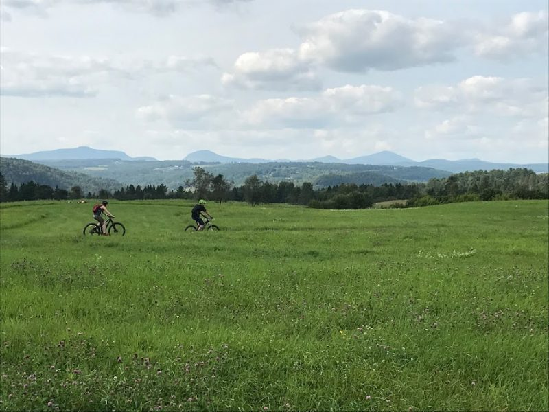 Some mountain bikers enjoying the scenery of Kingdom Trails.