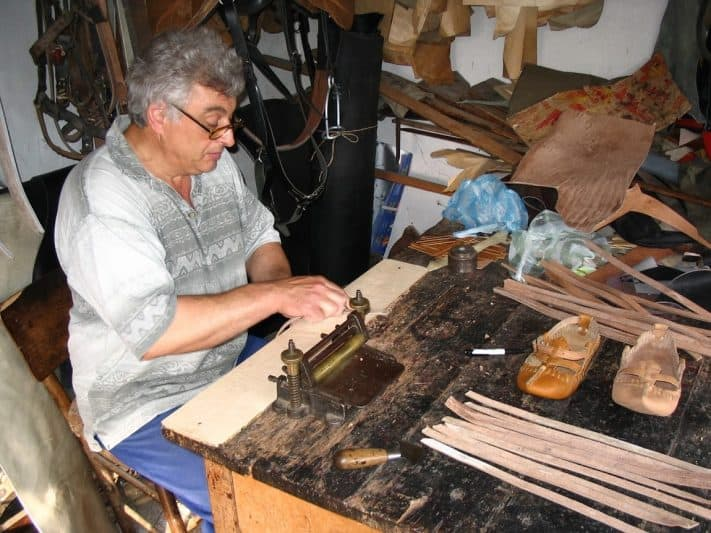 The ancient crafts are still being practiced in the mountain - leather-worker.