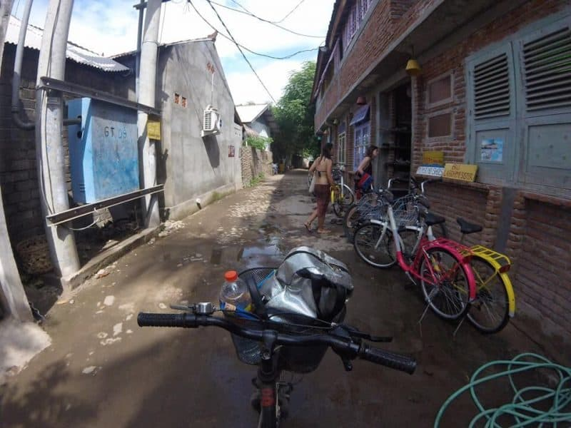 Bike riding down the backstreets of Gili T, Indonesia.