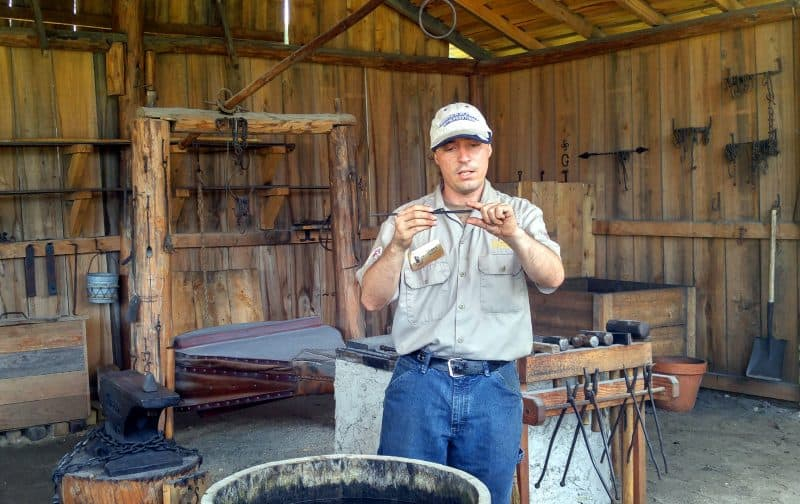 Nail making demonstration at the blacksmith's shop, Fountain of Youth Park, St. Augustine, FL.