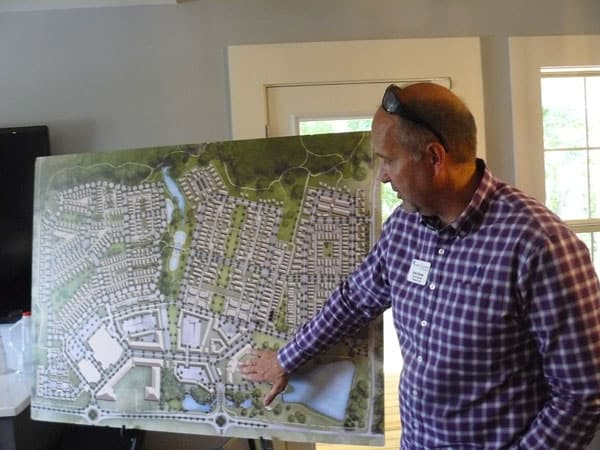 Planner Rob Parker with plans for Pinewood Forest, opposite Pinewood Studios in Fayatteville